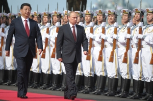 China's President Xi and his Russian counterpart Putin attend a ceremony to open the Chinese-Russian joint naval drills in Shanghai